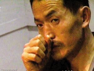 Фото китайского маньяка Яна Синьхая.